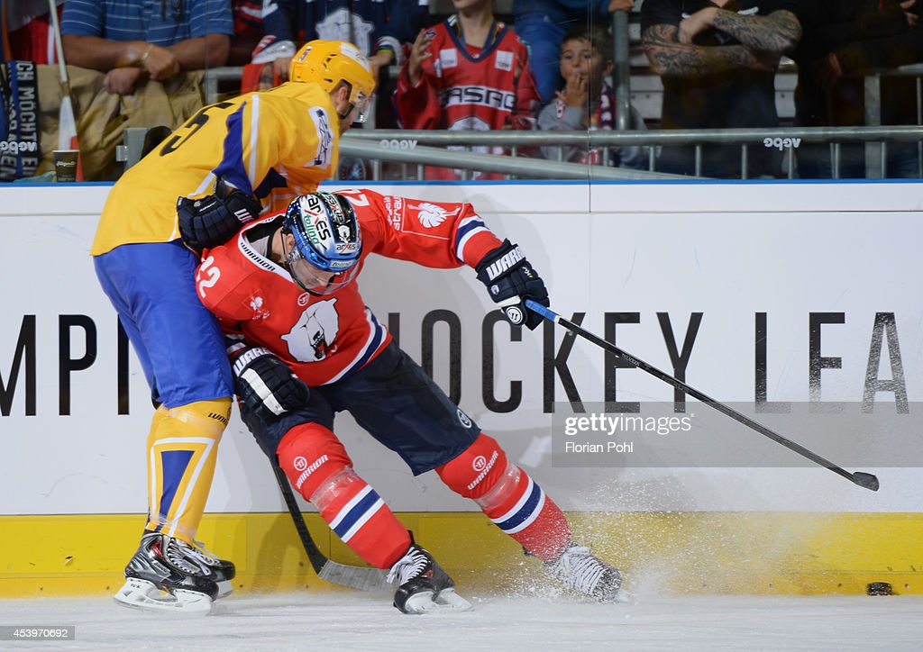 Barry Tallackson #22 of Eisbären Berlin and Tomas Zizka #5 of PSG Zlin body check during the Champions Hockey League group stage game between Eisbaeren Berlin and HC Zlin on August 22, 2014 in Berlin, Germany.
