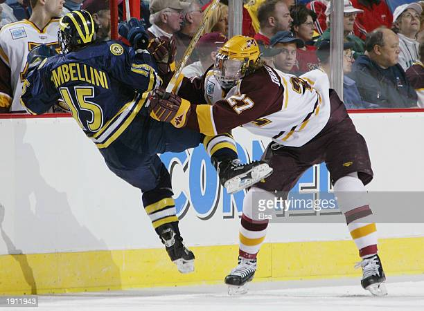 Barry Tallackson of Minnesota checks Jeff Tambellini of Michigan on April 10, 2003 during the NCAA Frozen Four at the HSBC Arena in Buffalo, New York.