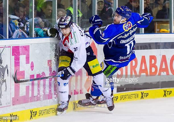 Barry Tallackson of the Eisbaeren Berlin and Florian Ondruschka of Straubing Tigers during the game between the Straubing Tigers and the Eisbaeren...