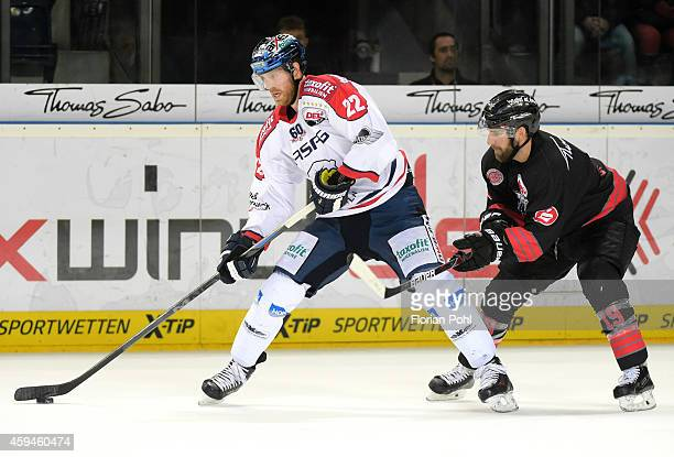 Barry Tallackson of the Eisbaeren Berlin and Jason Jaspers of the Thomas Sabo Ice Tigers Nuernberg in action during the game between Thomas Sabo Ice...