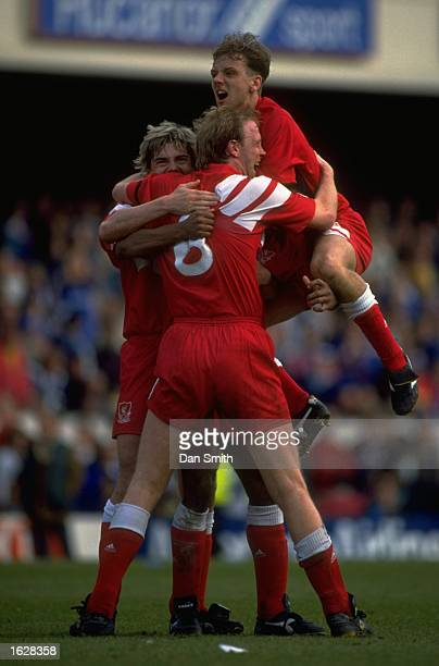 Barry Venison Mark Wright Rob Jones and John Barnes all of Liverpool celebrate a goal during the FA Cup SemiFinal against Portsmouth at Highbury in...