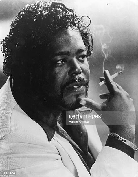 Barry White the American black soul singer smoking a cigarette