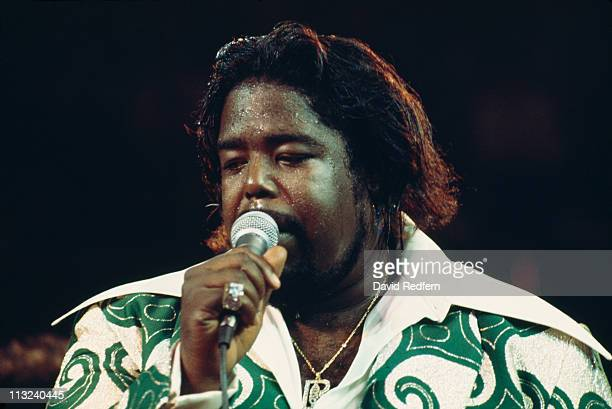 Barry White US soul singer singing into a microphone during a live concert performance circa 1975