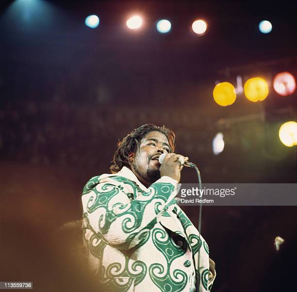 Barry White US soul singer singing into a microphone during a live concert performance at the Royal Albert Hall London England Great Britain in May...