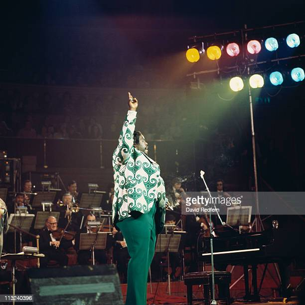Barry White US soul singer stands with his arm raised in the air during a live concert performance at the Royal Albert Hall London England Great...