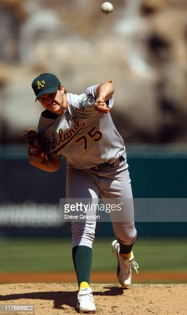 Barry Zito of the A's delivers a pitch in the first inning