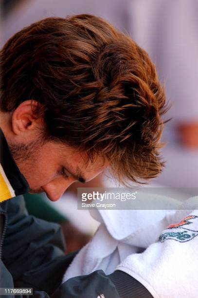 Barry Zito of the A's sits in the dugout in the seventh inning after losing his bid for a nohitter
