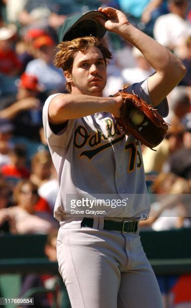 Barry Zito of the A's wipes his brow after giving up a single in the seventh inning losing his bid for a nohitter