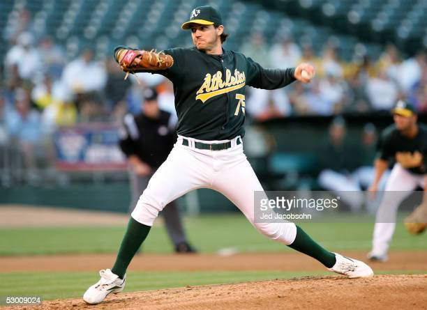 Barry Zito of the Oakland Athletics pitches against the Tampa Bay Devil Rays at McAfee Coliseum June 1, 2005 in Oakland, California.