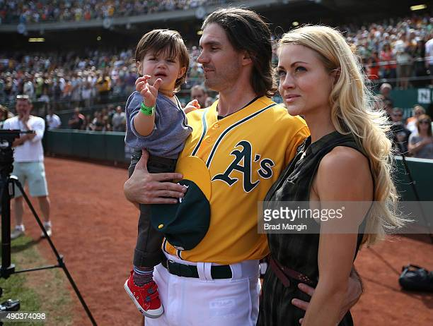 Barry Zito of the Oakland Athletics stands on the field with his son Marsden Zito and wife Amber Zito before the game against the San Francisco...