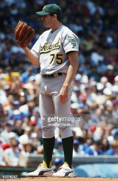 Barry Zito of the Oakland Athletics stands on the mound during the interleague game against the Chicago Cubs on June 20, 2004 at Wrigley Field in...