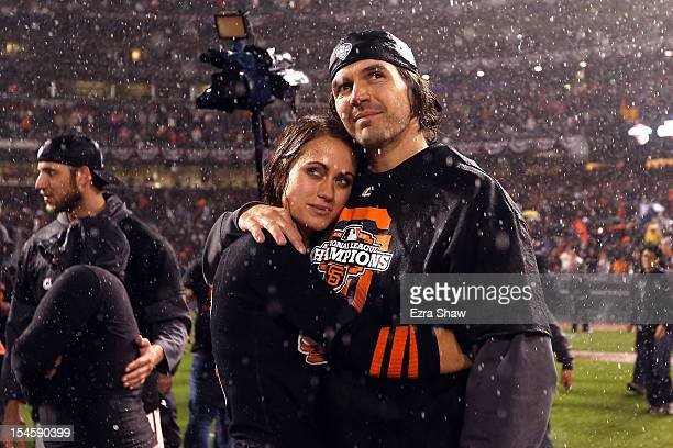 Barry Zito of the San Francisco Giants and wife Amber Zito celebrate after the Giants 90 victory against the St Louis Cardinals in Game Seven of the...