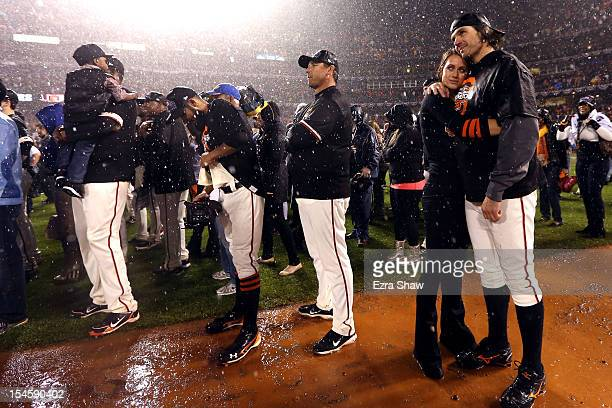 Barry Zito of the San Francisco Giants and wife Amber Zito celebrate after the Giants 9-0 victory against the St. Louis Cardinals in Game Seven of...