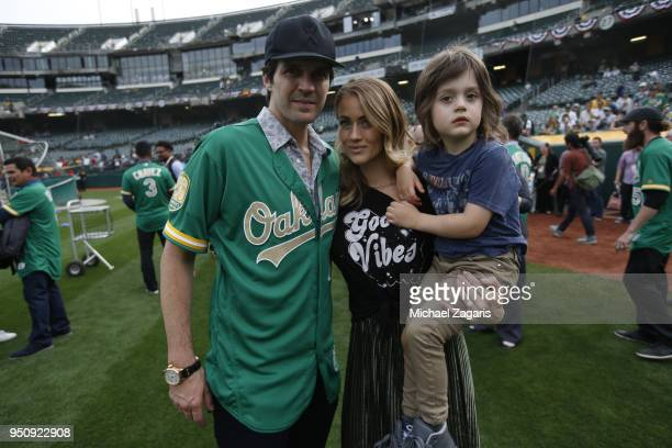Barry Zito stand on the field with his wife Amber and son prior to a pregame ceremony honoring the Oakland Athletics 50th Anniversary Team prior to...