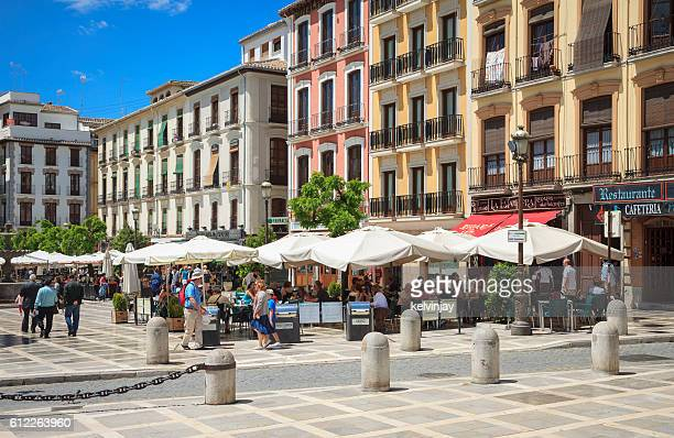 Bars and restaurants in a plaza in Granada, Spain