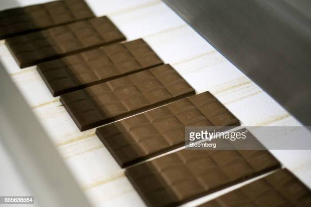 Bars of AlpenGold brand chocolate bars move along a conveyor belt on the production line at the Trostyanets confectionery plant operated by Mondelez...