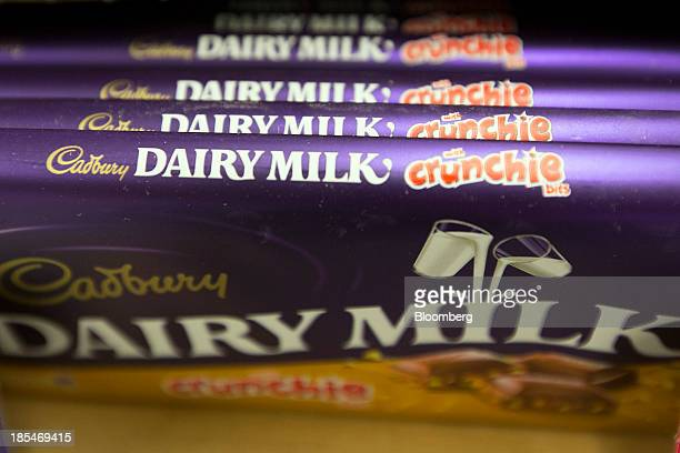 Bars of Cadbury 'Dairy Milk Crunchie' chocolate manufactured by Kraft Foods Inc sit displayed for sale inside an Asda supermarket the UK retail arm...