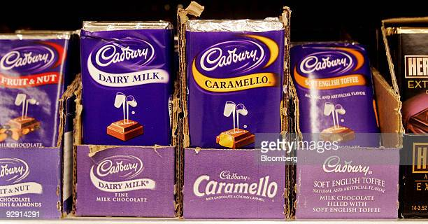 Bars of Cadbury Plc's chocolate sit on display at a grocery store in Raleigh North Carolina US on Sunday Nov 8 2009 Kraft Foods Inc the maker of...