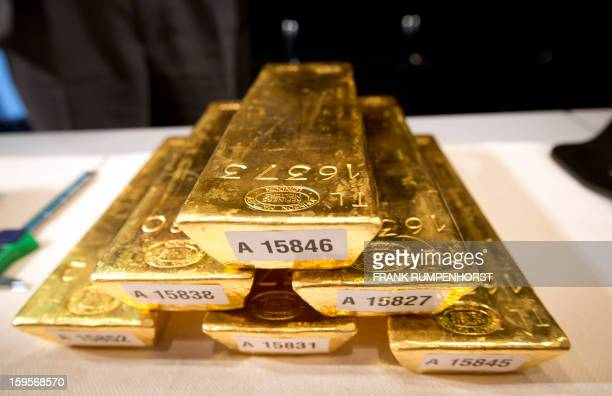Bars of gold are piled up during a press conference at the German Federal Bank in Frankfurt am Main western Germany on January 16 2013The German...