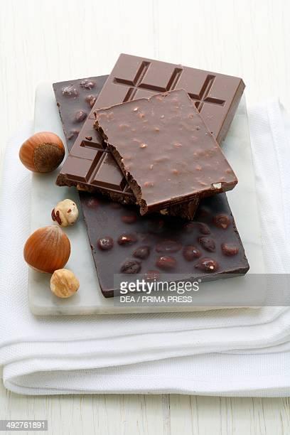 Bars of milk chocolate with hazelnuts and dark chocolate with hazelnuts