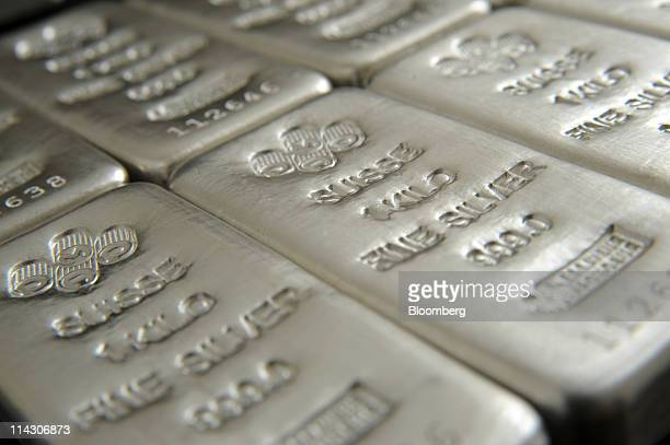 Bars of onekilogram silver featuring the stamp of Swiss company Produits Artistiques Metaux Precieux are arranged for a photograph at the offices of...