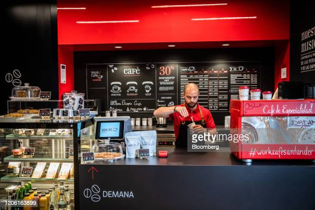 A barsita serves coffee inside the Banco Santander SA Work Cafe coworking space in Barcelona Spain on Friday March 6 2020 Spanish bank shares soared...
