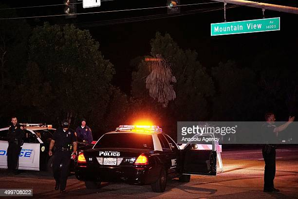 Barstow police officers stand guard as they investigate the crime scene on December 2 2015 in San Bernardino California Two suspects in a deadly mass...