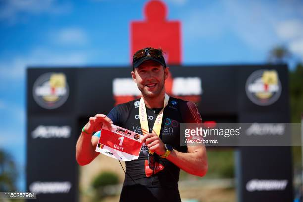 Bart Aernouts of Belgium celebrates winning IRONMAN 703 Barcelona on May 19 2019 in Calella Spain