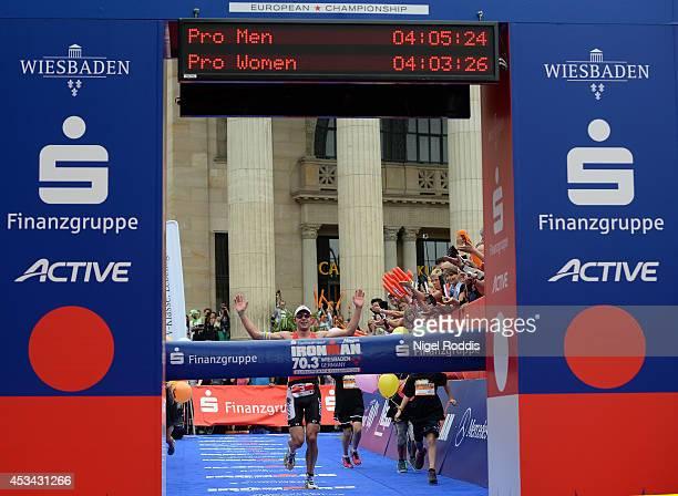 Bart Aernouts of Belgium wins the Ironman 703 Wiesbaden on August 10 2014 in Wiesbaden Germany