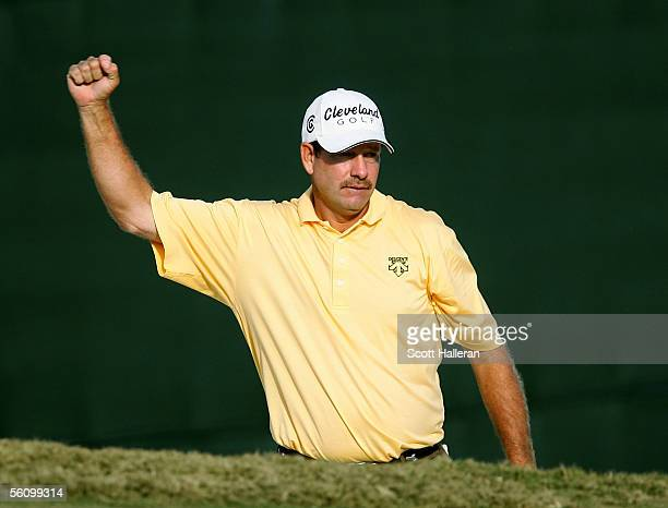 Bart Bryant celebrates a birdie on the 18th green after holing out from a greenside bunker during the third round of the PGA Tour Championship at...