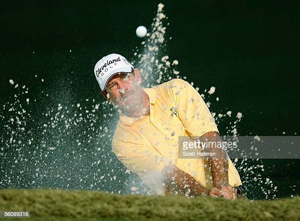 Bart Bryant plays a shot from a greenside bunker on the 18th hole during the third round of the PGA Tour Championship at East Lake Golf Club on...