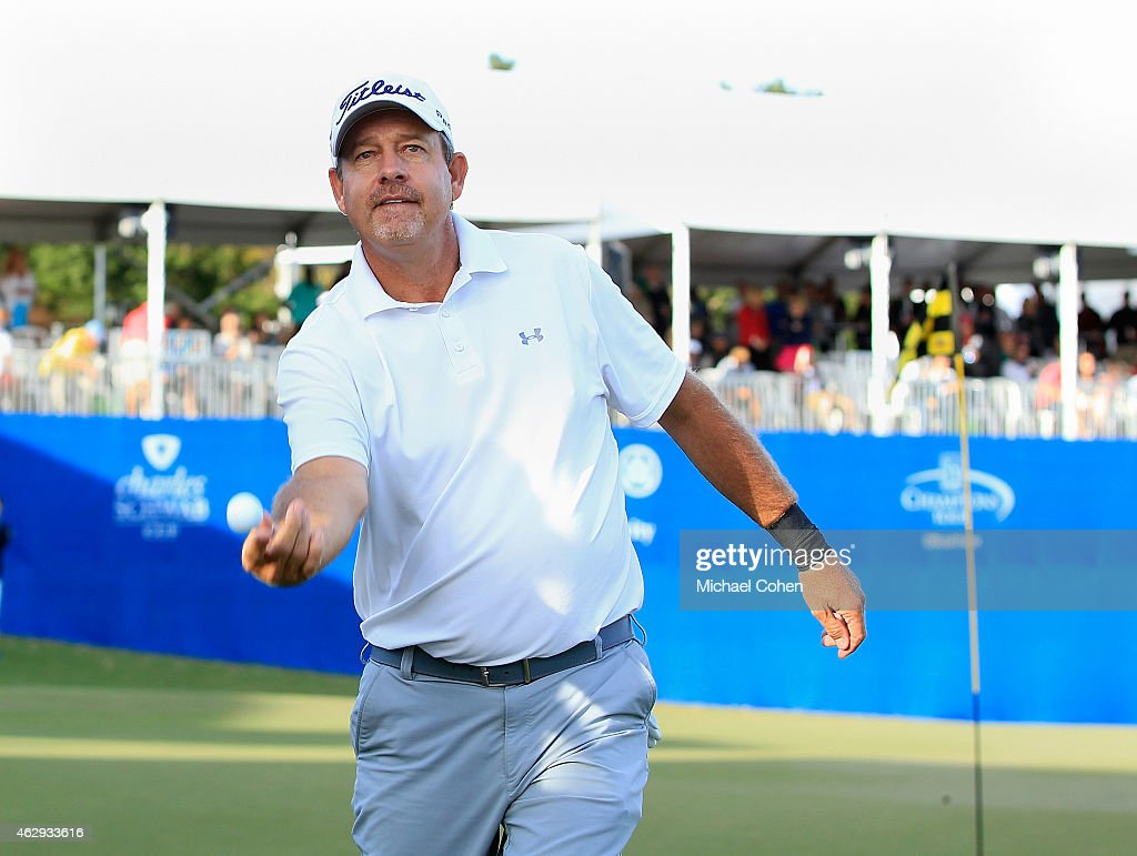 Bart Bryant tosses his ball to the gallery after making a double eagle on the 18th hole to move into a tie for the lead at nine under par during the second round of the Allianz Championship held at The Old Course at Broken Sound on February 7, 2015 in Boca Raton, Florida.