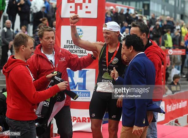 Bart Colpaert of Belgium celebrates winning the men's race during the Challenge Triathlon Almere-Amsterdam on September 14, 2013 in Almere,...