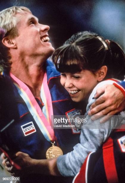 Bart Conner and Michelle Dusserre of the United States gymnastics team celebrate after an awards ceremony during the Men's Gymnastics competition of...