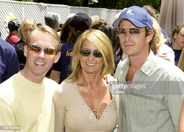 Bart Conner Nadia Comaneci Luke Perry during Target A Time For Heroes To Benefit The Elizabeth Glaser Pediatric AIDS Foundation at Mandeville Canyon...