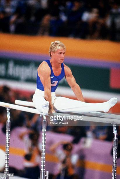 Bart Conner of the United States performs his routine in the Men's parallel bars competition on 4th August 1984 during the XXIII Olympic Summer Games...