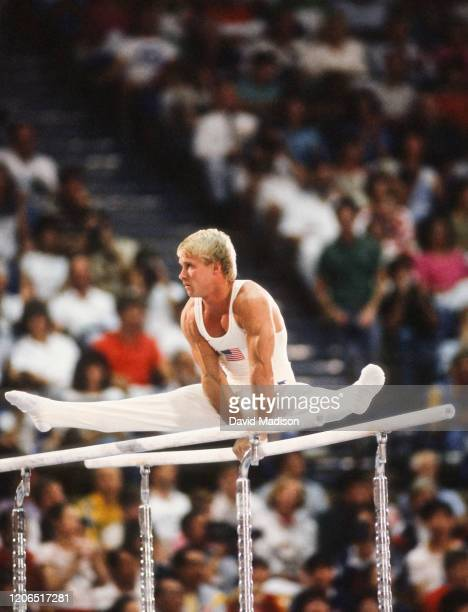 Bart Conner of the USA performs in the parallel bars event during the Men's Gymnastics competition of the 1984 Summer Olympic Games held from July 30...