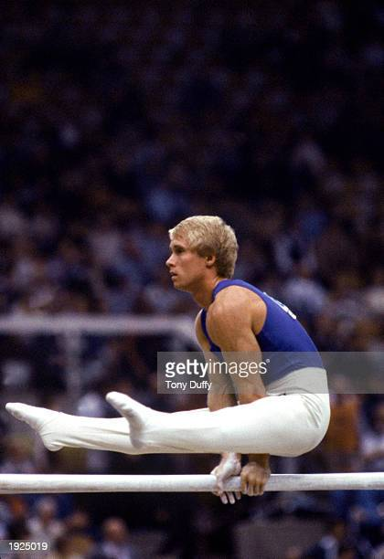 Bart Conner of the USA performs on the parallel bars during the 1984 Olympic Games in Los Angeles, California.