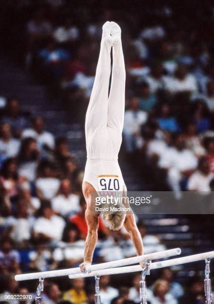 Bart Conner of the USA performs on the parallel bars during the Men's Gymnastics competition of the 1984 Summer Olympic Games held from July 30 to...