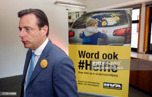 Bart De Wever, head of the New Flemish Alliance and mayor or Antwerp, walks past an N-VA poster at the launch of his party's spring campaign in...