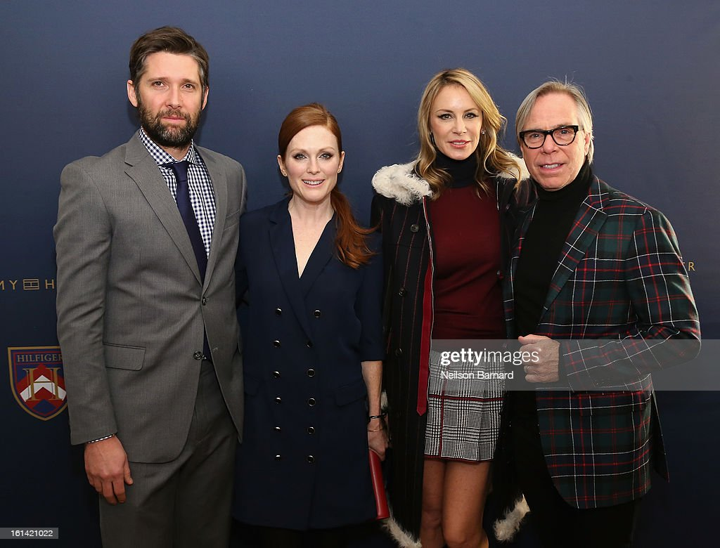 Bart Freundlich, Actress Julianne Moore, Dee Hilfiger, Tommy Hilfiger attend the Tommy Hilfiger Fall 2013 Women's Collection fashion show during Mercedes-Benz Fashion Week at the Park Avenue Armory on February 10, 2013 in New York City.