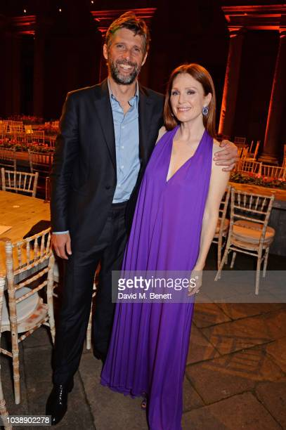 Bart Freundlich and Julianne Moore attend The Green Carpet Fashion Awards Italia 2018 after party at Gallerie d'Italia on September 23 2018 in Milan...