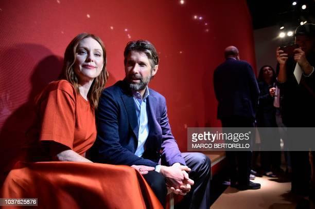 Bart Freundlich and Julianne Moore attend the Salvatore Ferragamo show during Milan Fashion Week Spring/Summer 2019 on September 22 2018 in Milan...
