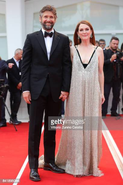 Bart Freundlich and Julianne Moore walk the red carpet ahead of the 'Suburbicon' screening during the 74th Venice Film Festival at Sala Grande on...