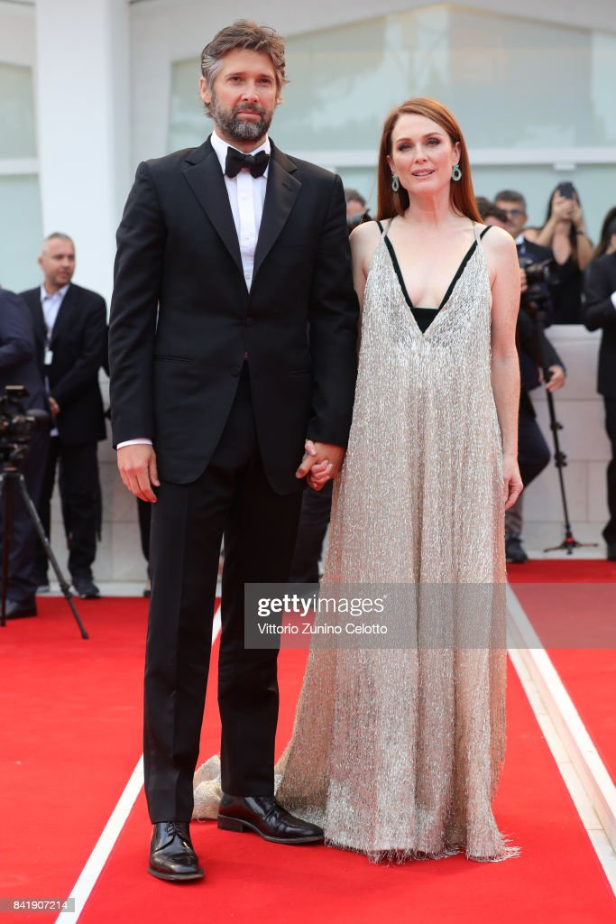 Bart Freundlich and Julianne Moore walk the red carpet ahead of the 'Suburbicon' screening during the 74th Venice Film Festival at Sala Grande on September 2, 2017 in Venice, Italy.