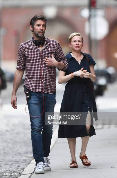 Bart Freundlich and Michelle Williams are seen on the set of After The Wedding on May 29 2018 in New York City