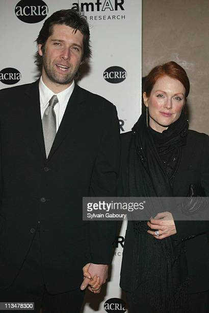 Bart Freundlich Julianne Moore during amfAR and ACRIA Honor Herb Ritts for His Work and Activism at Sotheby's in New York New York United States
