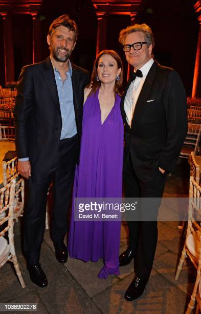 Bart Freundlich Julianne Moore wearing Ferragamo and Colin Firth attend The Green Carpet Fashion Awards Italia 2018 after party at Gallerie d'Italia...