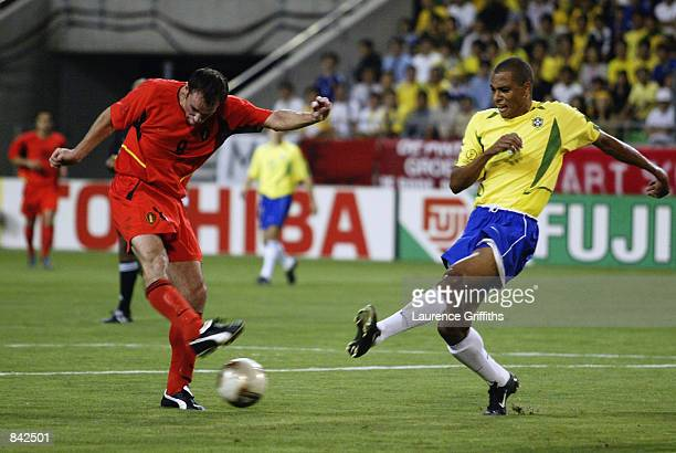 Bart Goor of Belgium fires a shot wide during the FIFA World Cup Finals 2002 Second Round match between Brazil and Belgium played at the Kobe Wing...