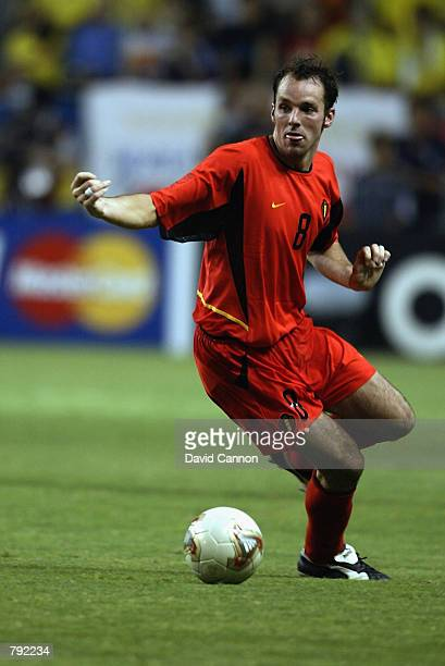 Bart Goor of Belgium runs with the ball during the FIFA World Cup Finals 2002 Second Round match between Brazil and Belgium played at the Kobe Wing...